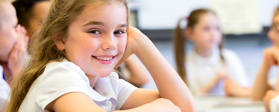 Girl in a classroom: social skills are the basis of the affective curriculum.