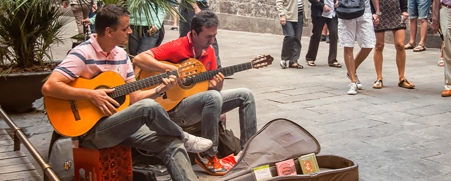 Street performers contribute to the city soundscape.