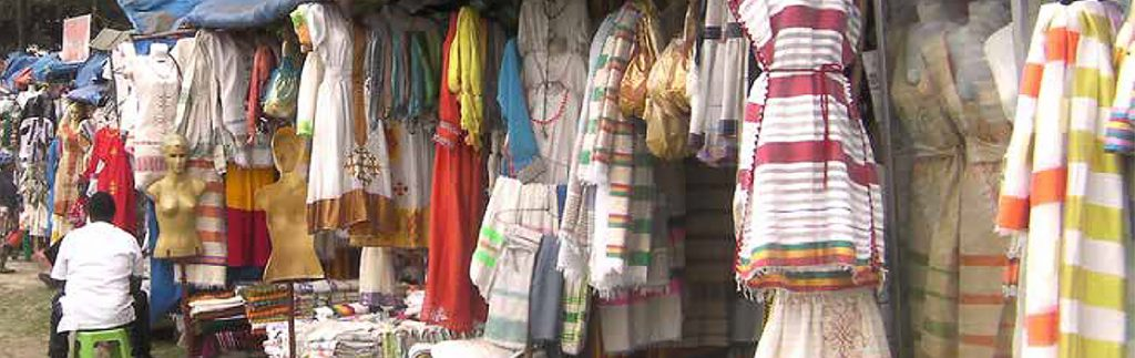 Handloom-woven clothes talls in Shiro Meda market, Addis Ababa
