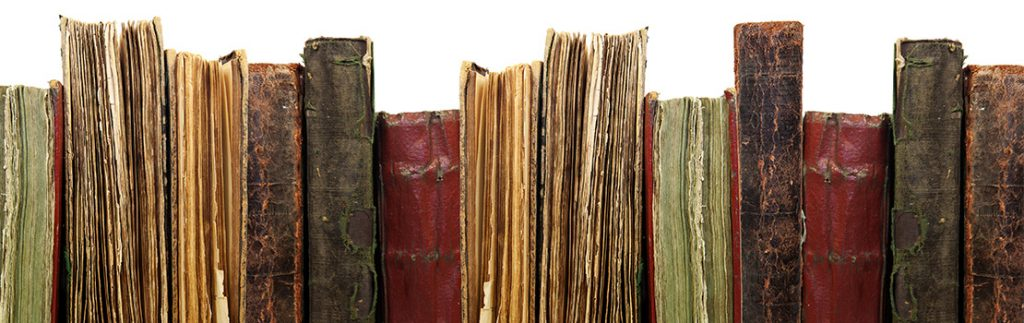 A row of old books and manuscripts