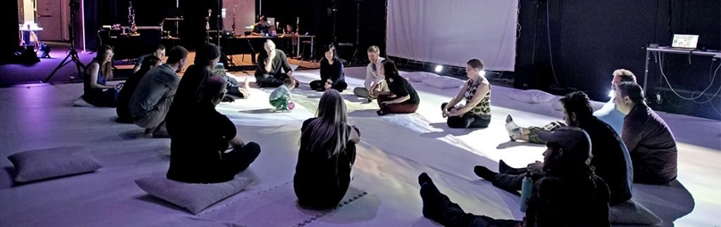 Professor Sha teaches a group of students