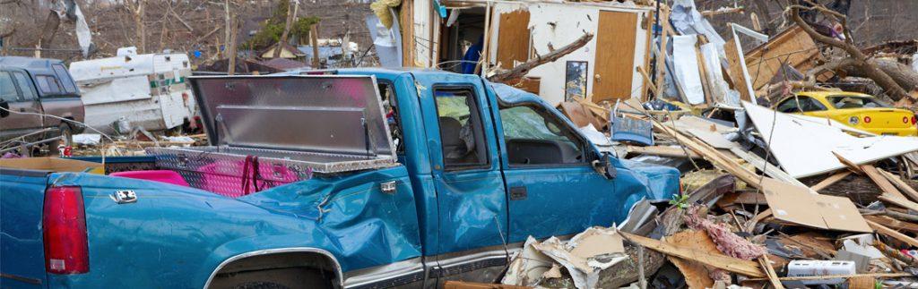 tornado damage: crushed van, crushed house