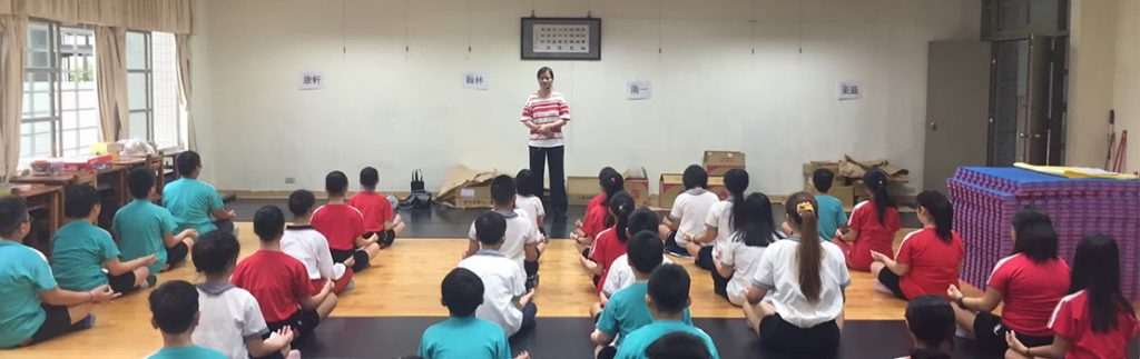 A group of school children are taught focus training