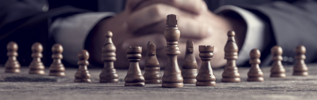 a person contemplates a chess move
