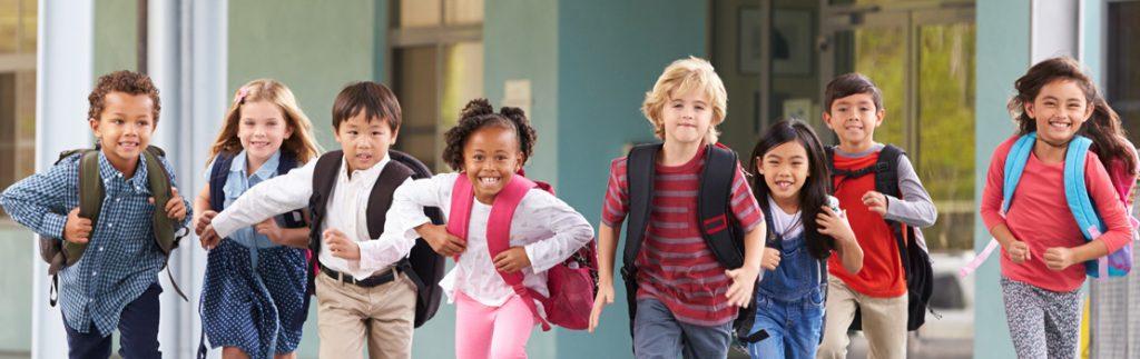a group of school children outside school