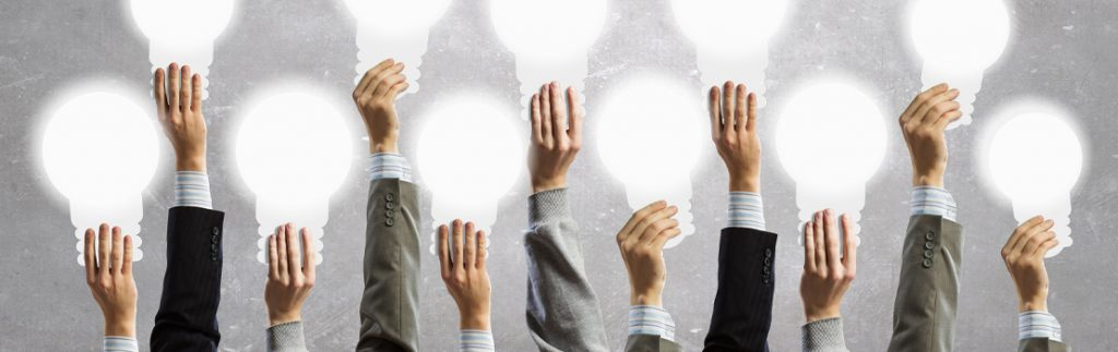 hands raise lightbulbs, collective ideas