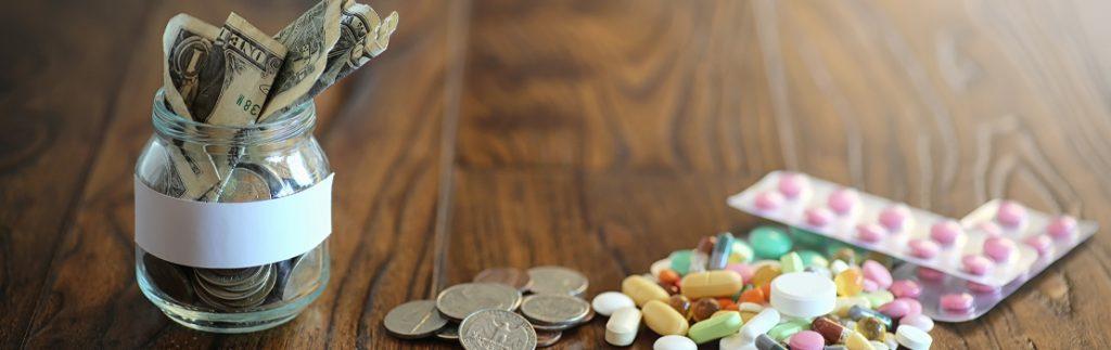 pills alongside a pot of money