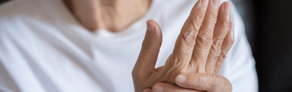 arthritis patient clutches hand